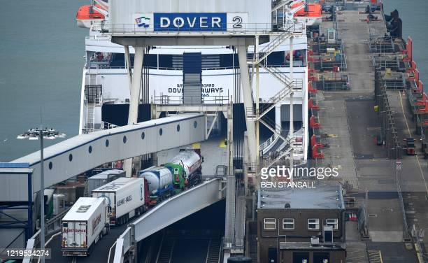 Freight lorries drive on to a ferry before leaving from the Port of Dover, in Dover on the south coast of England on June 12, 2020. - Britain will...