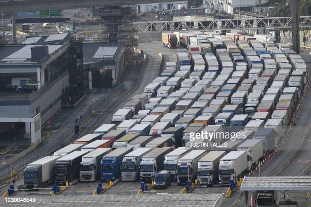 Freight lorries queue to enter the port of Dover on the south coast of England on December 10, 2020. - Big queues of lorries snaked into the port of...