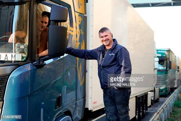 Freight lorry drivers from Poland, who have travelled 11 kilometers in 19 hours, talk as they remain queued up on the M20 motorway, southbound,...