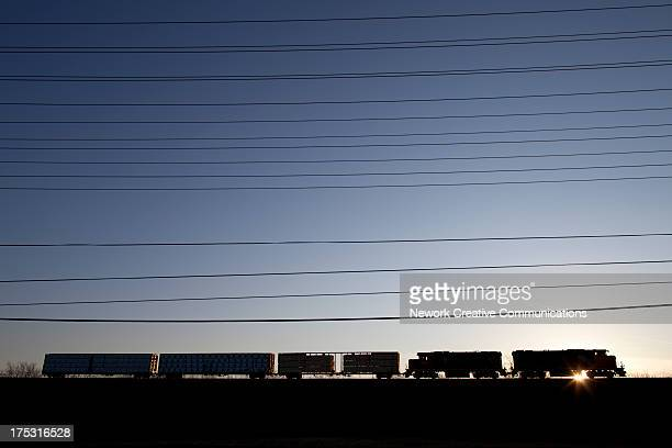 Freight train and power lines at sunset. Milton, Ontario, Canada, 2012.
