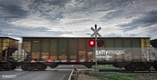 freight train and railroad crossing - crossing sign stock pictures, royalty-free photos & images