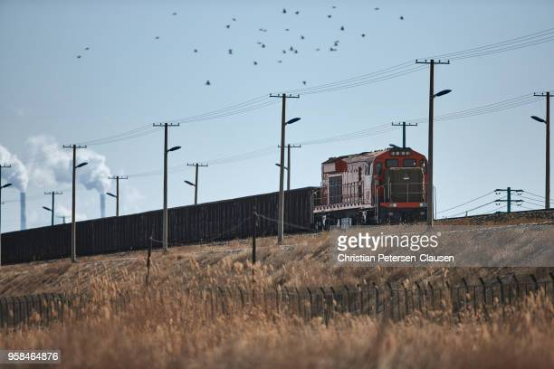 Freight train at industrial area transporting coal