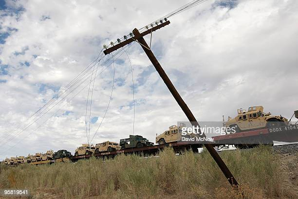 A freight train carries military Humvee vehicles along the southern San Andreas earthquake fault on January 16 2010 south of Mecca California The...