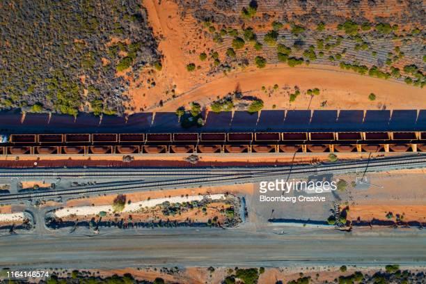 a freight train carry's iron ore from mine to port - porträt bildbanksfoton och bilder