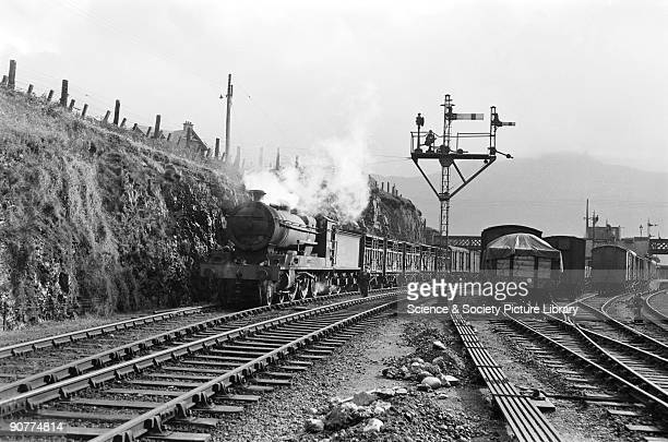 Freight train hauled by a 460 locomotive number 54767 Clan Mackinnon at Kyle of Lochalsh Scottish Highlands Photograph by Cyril Herbert Fish was...