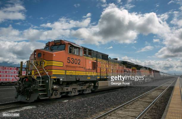 BNSF freight train hauling oil tankers loaded with crude oil heads west through the this downtown transcontinental railroad hub on June 22 in...