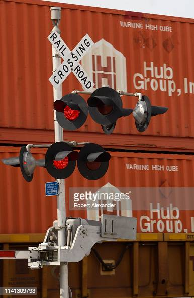A freight train loaded with Hub Group shipping containers