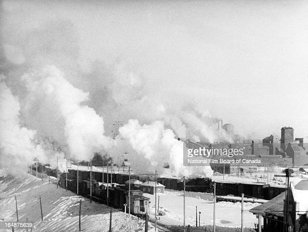 Freight train loaded with raw materials arrives in Shawinigan, Quebec, Canada, 1951. Photo taken during the National Film Board of Canada's...
