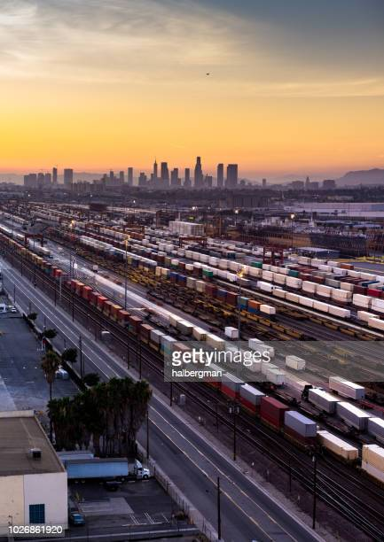 Freight Train Loading in Vernon with Los Angeles Skyline at Sunset