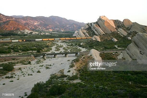 Freight train moves past the Mormon Rocks in Cajon Canyon, not far from the San Andreas Fault, on July 1, 2006 near San Bernardino, California. The...
