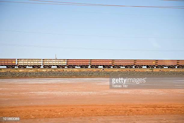 Freight train moving through a desert landscape,  Port Hedland, Western Australia, Australia