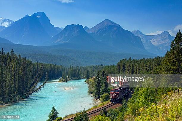 Freight train of Canadian Pacific Railway along the Bow River at Morant's Curve Banff National Park Alberta Canadian Rockies Canada