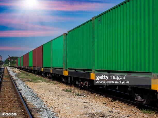 freight train on railroad track against sky - cargo train stock photos and pictures