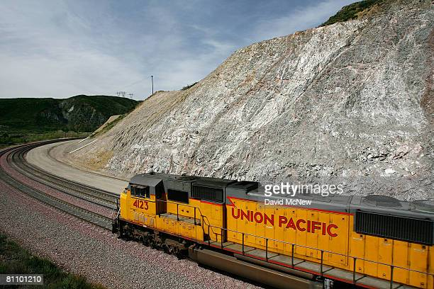 A freight train passes diagonallyshifted layers of earth as it crosses the San Andreas Rift Zone the system of depressions in the ground between the...