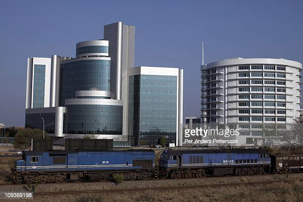 A freight train passes the Ministry of Health building and downtown on August 29 2010 in Gaborone Botswana The country is one of the smallest and...