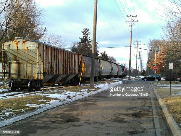 Freight Train Passing Through Railway Crossing