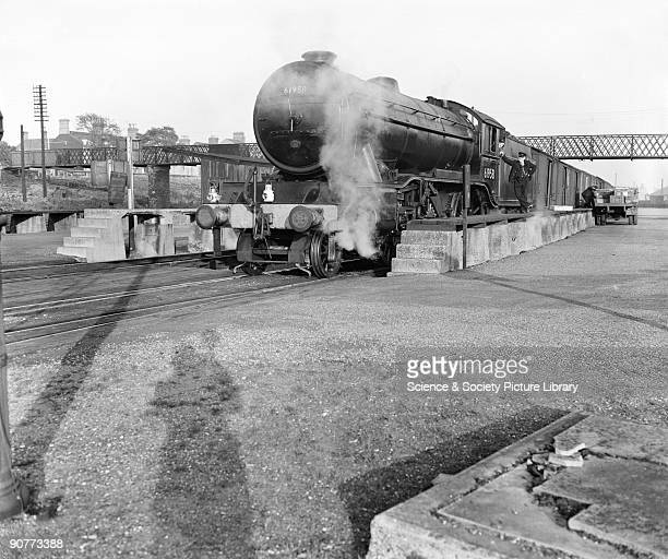 Freight train pulled by a K3 class 260 locomotive number 61958 having crates of fish loaded onto it Fish was transported in special ventilated or...