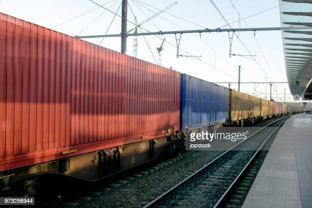 freight train with cargo containers - cargo train stock photos and pictures