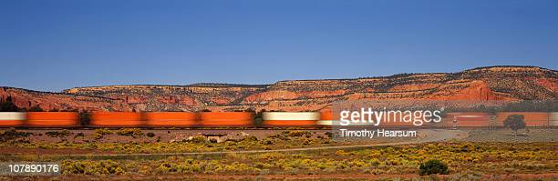 Freight train with red cliffs beyond