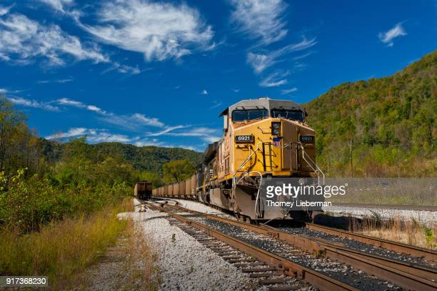 freight train with yellow diesel 2 - rail freight stock pictures, royalty-free photos & images