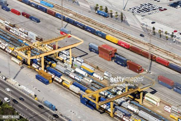 freight trains and containers in port of barcelona, spain - railroad stock pictures, royalty-free photos & images