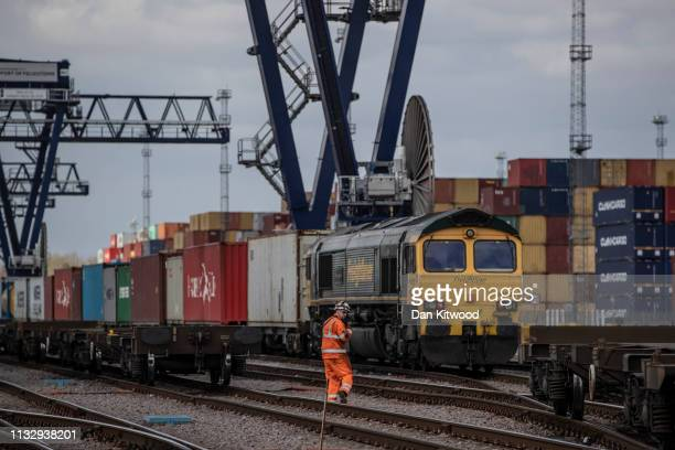 Freight trains carrying shipping containers stand in the rail terminal at the Port of Felixstowe Ltd a subsidiary of CK Hutchison Holdings Ltd on...