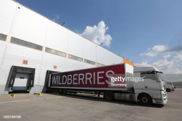 Workers wheel trolleys around the storage bay while collecting customers goods in the distribution center operated by Wildberries LLC an online...