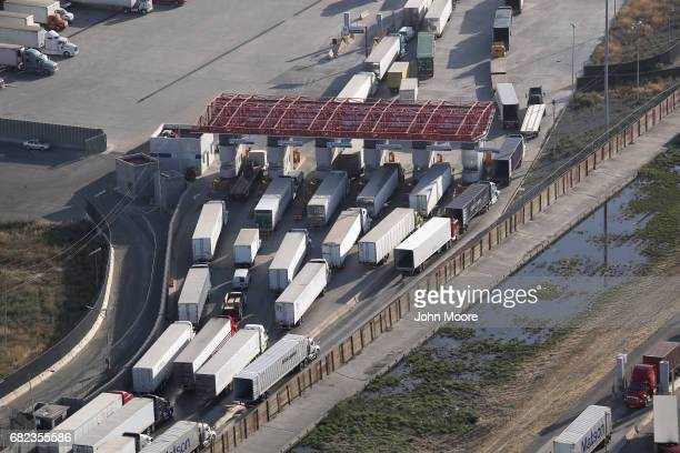 Freight trucks as seen from a helicopter pass through Mexican Customs before entering the United States at the Otay Mesa port of entry on May 11 2017...