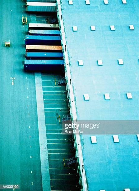 freight trucks in loading dock - landfahrzeug stock-fotos und bilder