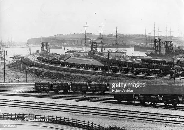 Freight trucks on the Railway at Barry Dock and Barry Island with sailing ships moored to the jetties