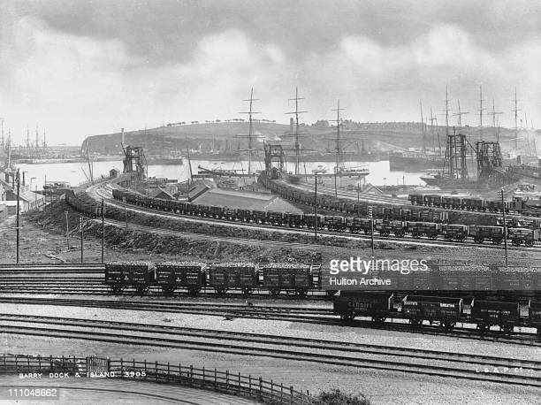 Freight trucks on the railway at Barry Docks and Barry Island with sailing ships moored to the jetties 1895