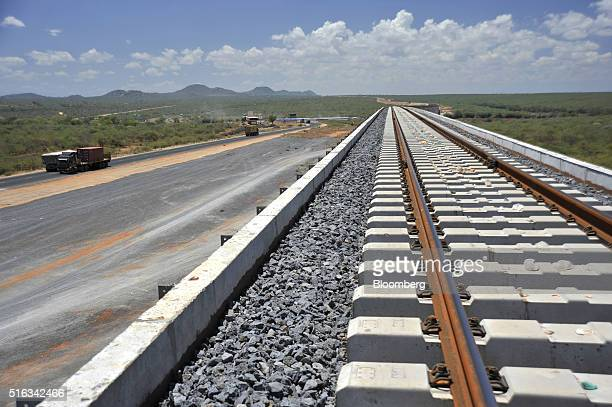 Freight trucks pass through the Tsavo national park beside newly laid rail track on the Tsavo superbridge which will form part of the new...
