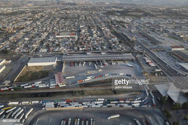 Freight trucks snake through customs into California from Mexico at the the Otay Mesa port of entry as seen from above on May 11 2017 in San Diego...
