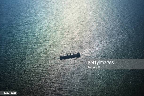 Freight vessels are seen in the waters of the South China Sea between the city of Xiamen in China and the island of Kinmen in Taiwan on February 02,...