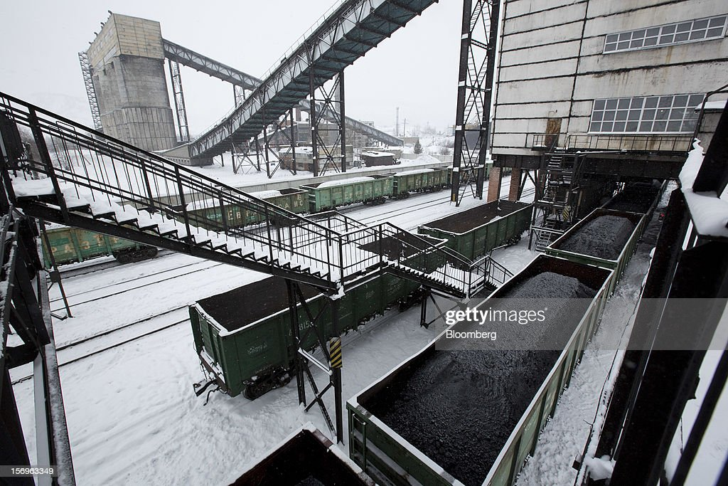 Freight wagons stand loaded with coal before shipping from the rail transport facility at the Sibirginsky open pit coal mine, owned by OAO Mechel and operated by Southern Kuzbass Coal Co., near Myski, in Kemerovo region of Siberia, Russia, on Friday, Nov. 23, 2012. OAO Mechel is Russia's biggest maker of steelmaking coal. Photographer: Andrey Rudakov/Bloomberg via Getty Images
