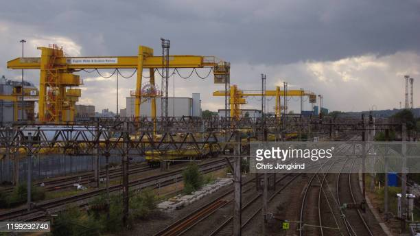 freight yard with cranes over trains and railways - horsedrawn stock pictures, royalty-free photos & images
