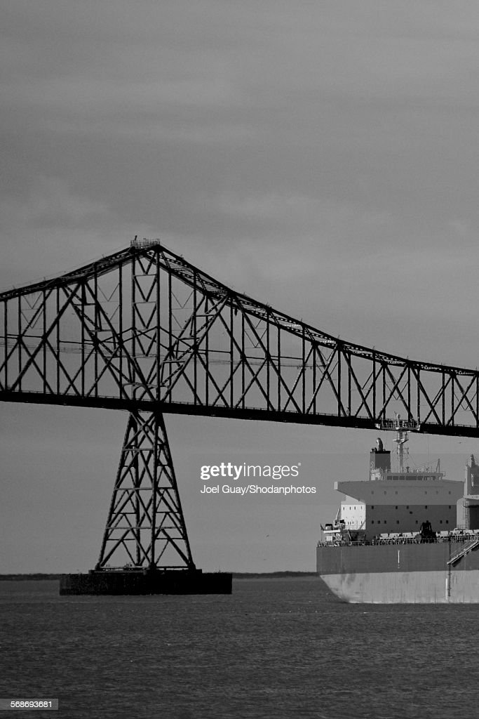 Freighter clearing astoria bridge on the columbia : Stock Photo