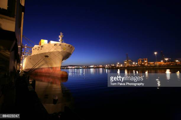 Freighter in port at night