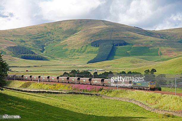 freightliner heavy haul coal train in scottish countryside - cargo train stock photos and pictures
