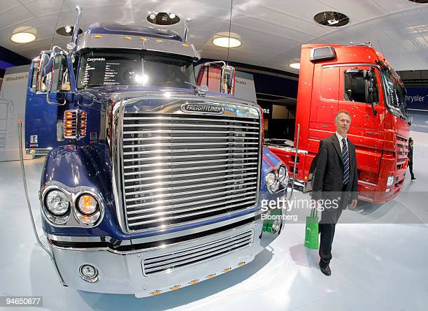Freightliner truck and a MercedesBenz truck are on display at the DaimlerChrysler stand at the IAA Commercial Vehicles Show in Hanover Germany on...