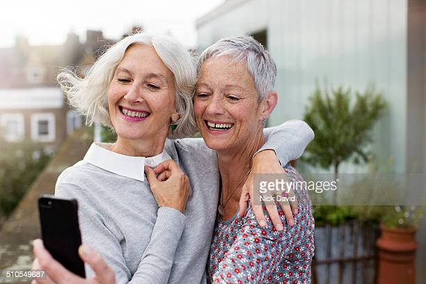 Freinds taking a selfie with mobile phone