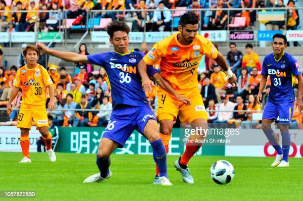 Freire of Shimizu SPulse and Shun Kawabe of Sanfrecce Hiroshima compete for the ball during the JLeague J1 match between Shimizu SPulse and Sanfrecce...