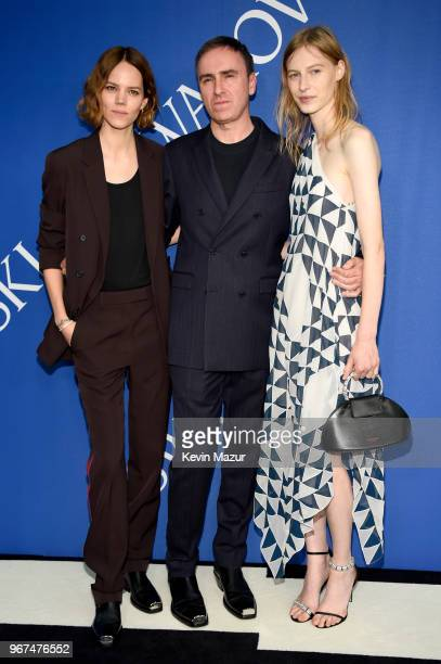 Freja Beha Erichsen Raf Simons and Julia Nobis attend the 2018 CFDA Fashion Awards at Brooklyn Museum on June 4 2018 in New York City