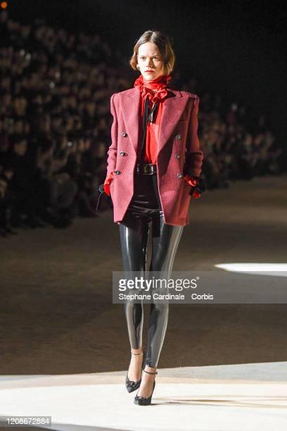 Freja Beha Erichsen walks the runway during the Saint Laurent show as part of the Paris Fashion Week Womenswear Fall/Winter 2020/2021 on February 25,...