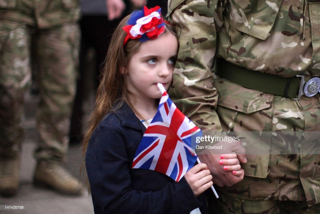 Freja Hinchliffe 5, stands with her father Major Jonathon Hinchliffe of 3rd Battalion the Yorkshire Regiment after a church service on March 16, 2012 in Warminster, England. The regiment earlier held a parade through Warminster Town centre which was the last of the units public appearance before being deployed to Afghanistan.