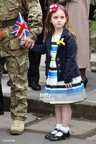 Freja Hinchliffe 5 stands with her father Major Jonathon Hinchliffe of 3rd Battalion the Yorkshire Regiment after a church service on March 16 2012...