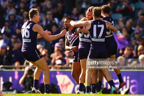 Fremantle celebrate the goal by Harley Bennell during the 2017 AFL round 22 match between the Fremantle Dockers and the Richmond Tigers at Domain...