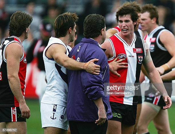 Fremantle coach Chris Connolly argues with Lenny Hayes for St Kilda at the end of the tied round five AFL match between the St Kilda Saints and the...