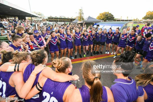 Fremantle sing the team song after the win amongst the fans of the side of the field during the 2019 NAB AFLW Round 07 match between the Fremantle...