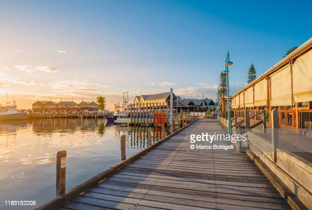 fremantle waterfront at sunset, perth, western australia. - perth australia stock pictures, royalty-free photos & images